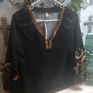Black and gold v neck blouse